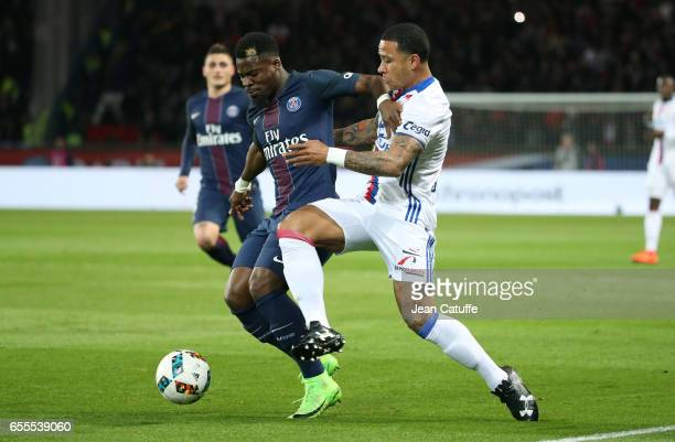 Serge Aurier of PSG and Memphis Depay of Lyon in action during the French Ligue 1 match between Paris SaintGermain and Olympique Lyonnais at Parc des...