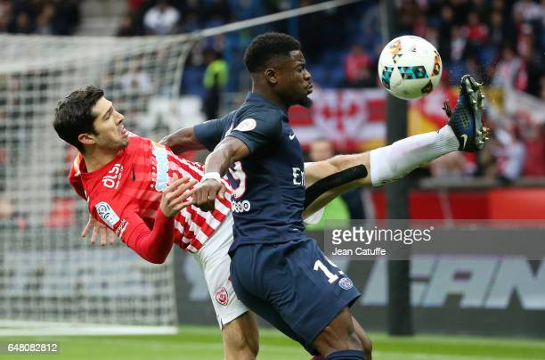 Serge Aurier of PSG and Vincent Muratori of Nancy in action during the French Ligue 1 match between Paris Saint Germain and AS Nancy Lorraine at Parc...