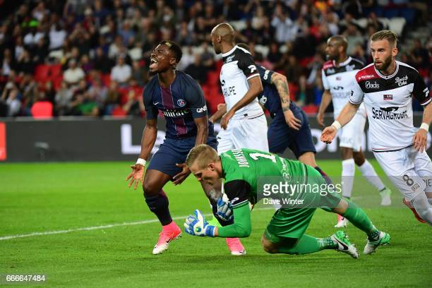 Serge Aurier of PSG reacts after Karl Johan Johnsson of Guingamp saves his shot during the French Ligue 1 match between Paris Saint Germain PSG and...