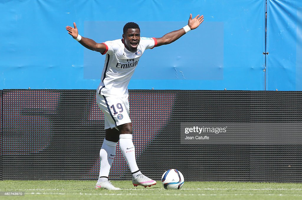 <a gi-track='captionPersonalityLinkClicked' href=/galleries/search?phrase=Serge+Aurier&family=editorial&specificpeople=6716046 ng-click='$event.stopPropagation()'>Serge Aurier</a> of PSG reacts during the 2015 Trophee des Champions between Paris Saint-Germain (PSG) and Olympique Lyonnais (OL) at Stade Saputo on August 1, 2015 in Montreal, Quebec, Canada.