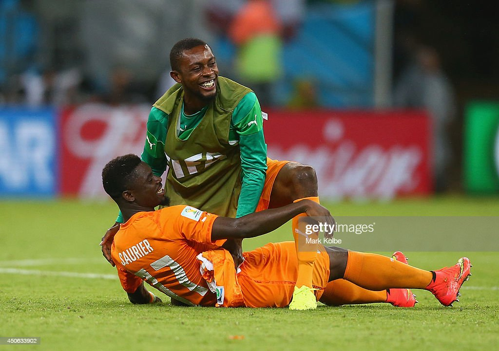 <a gi-track='captionPersonalityLinkClicked' href=/galleries/search?phrase=Serge+Aurier&family=editorial&specificpeople=6716046 ng-click='$event.stopPropagation()'>Serge Aurier</a> of the Ivory Coast (L) and <a gi-track='captionPersonalityLinkClicked' href=/galleries/search?phrase=Jean-Daniel+Akpa-Akpro&family=editorial&specificpeople=9941256 ng-click='$event.stopPropagation()'>Jean-Daniel Akpa-Akpro</a> of the Ivory Coast hug after defeating Japan 2-1 during the 2014 FIFA World Cup Brazil Group C match between the Ivory Coast and Japan at Arena Pernambuco on June 14, 2014 in Recife, Brazil.