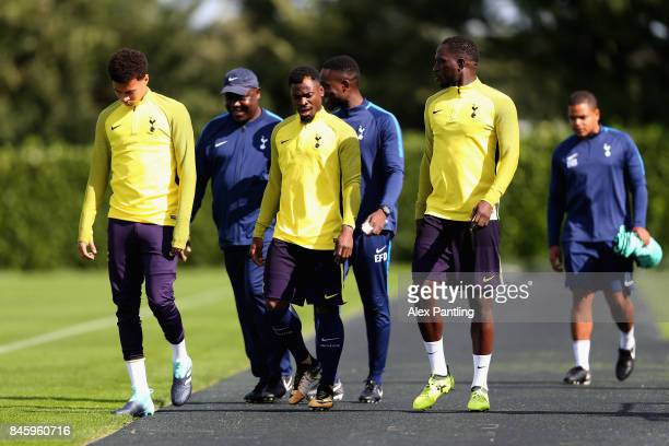 Serge Aurier of Tottenham Hotspur and team mates walk out onto the pitch during a Tottenham Hotspur training session ahead of their UEFA Champions...