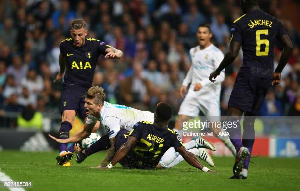 Serge Aurier of Tottenham Hotspur fouls Toni Kroos of Real Madrid leading a penalty during the UEFA Champions League group H match between Real...