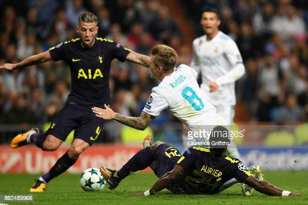 Serge Aurier of Tottenham Hotspur fouls Toni Kroos of Real Madrid and a penalty is awarded during the UEFA Champions League group H match between...