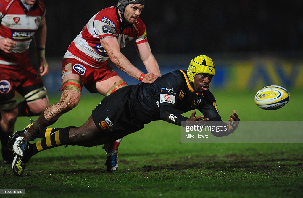 <a gi-track='captionPersonalityLinkClicked' href=/galleries/search?phrase=Serge+Betsen&family=editorial&specificpeople=239034 ng-click='$event.stopPropagation()'>Serge Betsen</a> of Wasps passes the ball after being tackled by <a gi-track='captionPersonalityLinkClicked' href=/galleries/search?phrase=Andy+Hazell&family=editorial&specificpeople=234356 ng-click='$event.stopPropagation()'>Andy Hazell</a> of Gloucester during the AVIVA Premiership match between London Wasps and Gloucester Rugby at Adams Park on February 13, 2011 in High Wycombe, England.