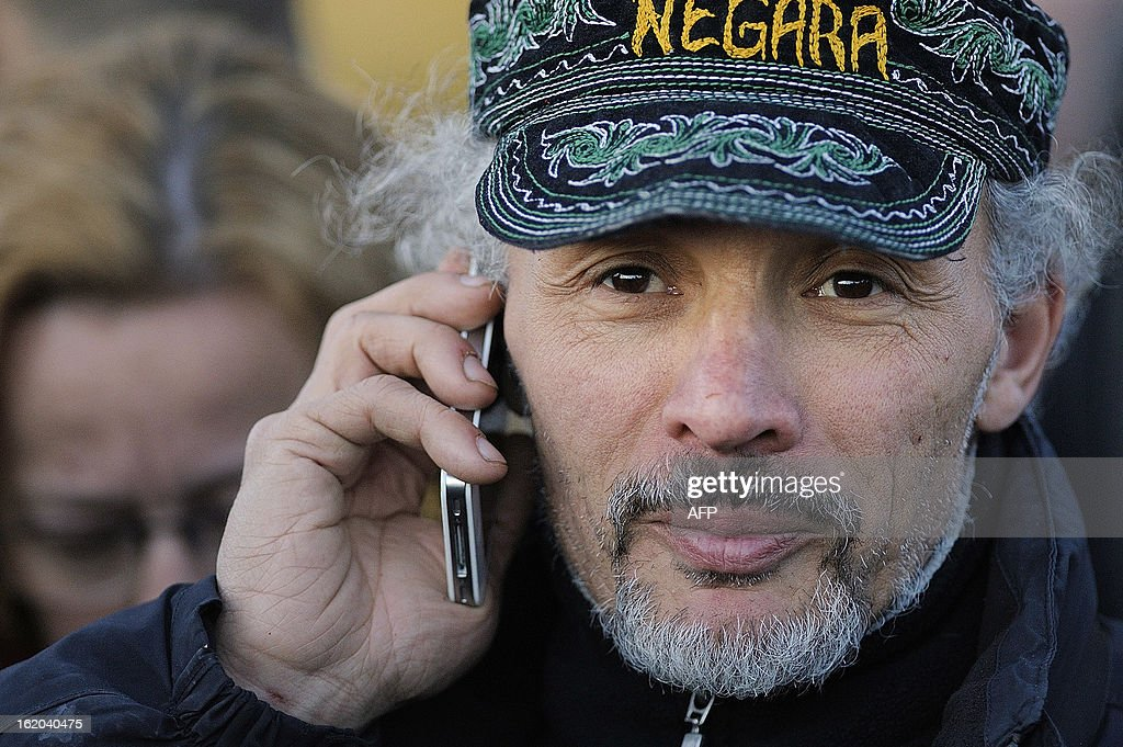Serge Charnay, a father denied access to his son, gives a call after coming down from a 43-meter crane on February 18, 2013 in Nantes, on the fourth day of a protest for his rights as a father. AFP PHOTO JEAN-SEBASTIEN EVRARD