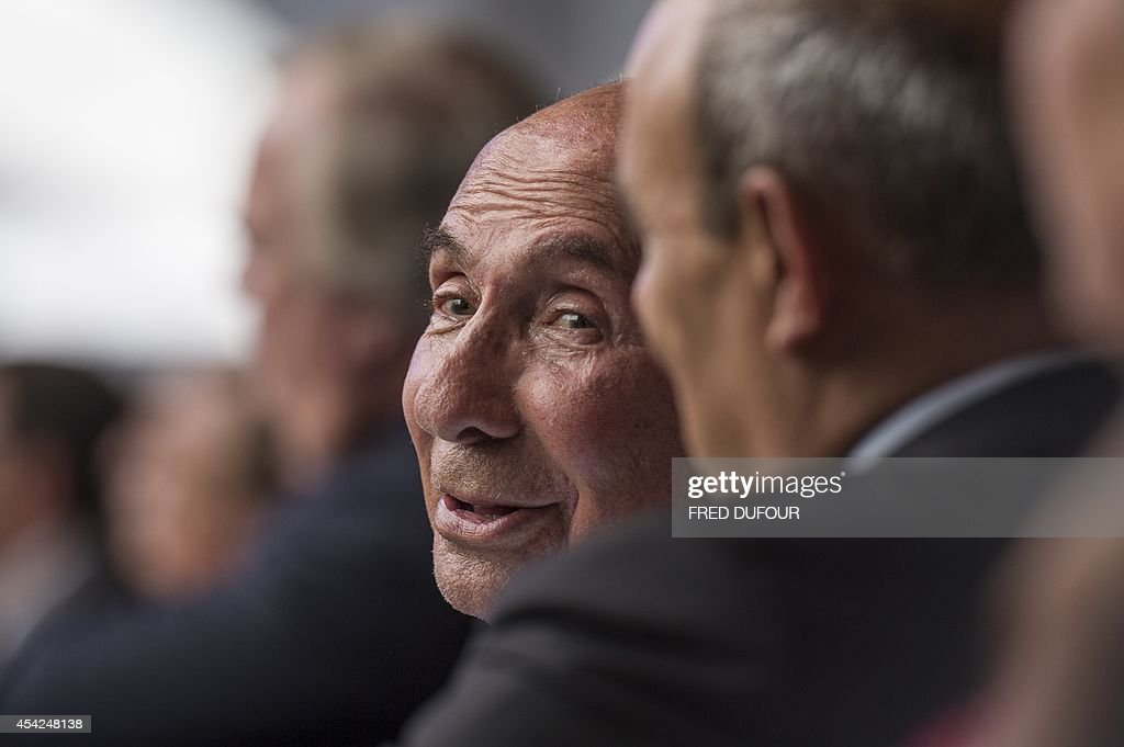 Serge Dassault, Chairman and CEO of Dassault Group and French Senator smiles as he listens to French prime minister's speech at the French employers' association Medef summer conference on August 27, 2014 in Jouy-en-Josas, southwest of Paris. Medef President Pierre Gattaz on August 27 called on France's new government to 'dare reforms'.