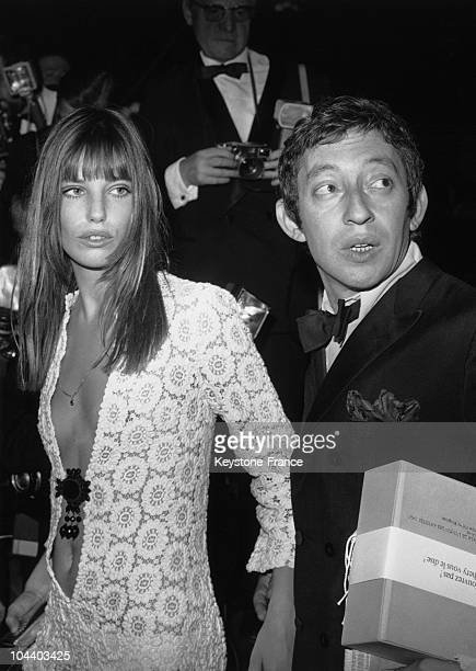 Serge GAINSBOURG and Jane BIRKIN arriving at the Artists Union's Gala Paris