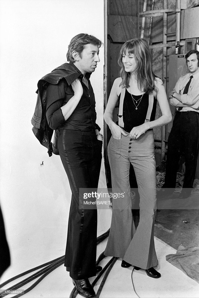 <a gi-track='captionPersonalityLinkClicked' href=/galleries/search?phrase=Serge+Gainsbourg&family=editorial&specificpeople=775960 ng-click='$event.stopPropagation()'>Serge Gainsbourg</a> and <a gi-track='captionPersonalityLinkClicked' href=/galleries/search?phrase=Jane+Birkin&family=editorial&specificpeople=159385 ng-click='$event.stopPropagation()'>Jane Birkin</a> in Paris, France on August 08, 1977 - On the French TV studio set at the Buttes Chaummont.