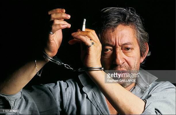 Serge Gainsbourg portraits with handcuffs in Paris France in October1987