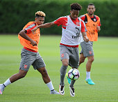 Serge Gnabry and Chris Willock of Arsenal during a training session at London Colney on July 21 2016 in St Albans England