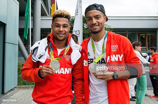 Serge Gnabry and Jeremy Toljan present their silver medals during the German Men's Olympic football team welcome home reception at DFB Headquarter on...