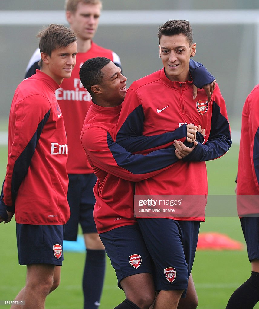 Serge Gnabry and Mesut Oezil of Arsenal during a training session at London Colney on September 24, 2013 in St Albans, England.