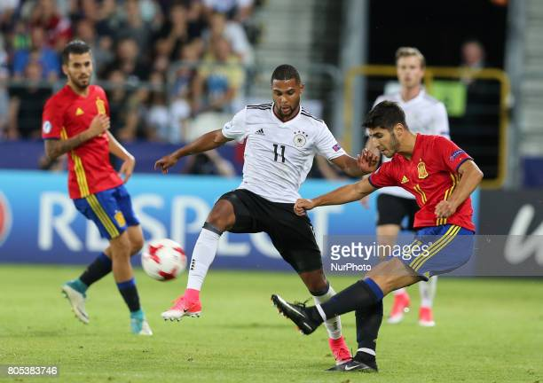 Serge Gnabry Marco Asensio during the UEFA U21 Final match between Germany and Spain at Krakow Stadium on June 30 2017 in Krakow Poland