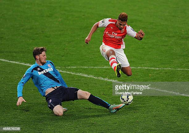 Serge Gnabry of Arsenal breaks past Ryan O'Reilly of Stoke during the U21's Premier League match between Arsenal and Stoke City at Emirates Stadium...