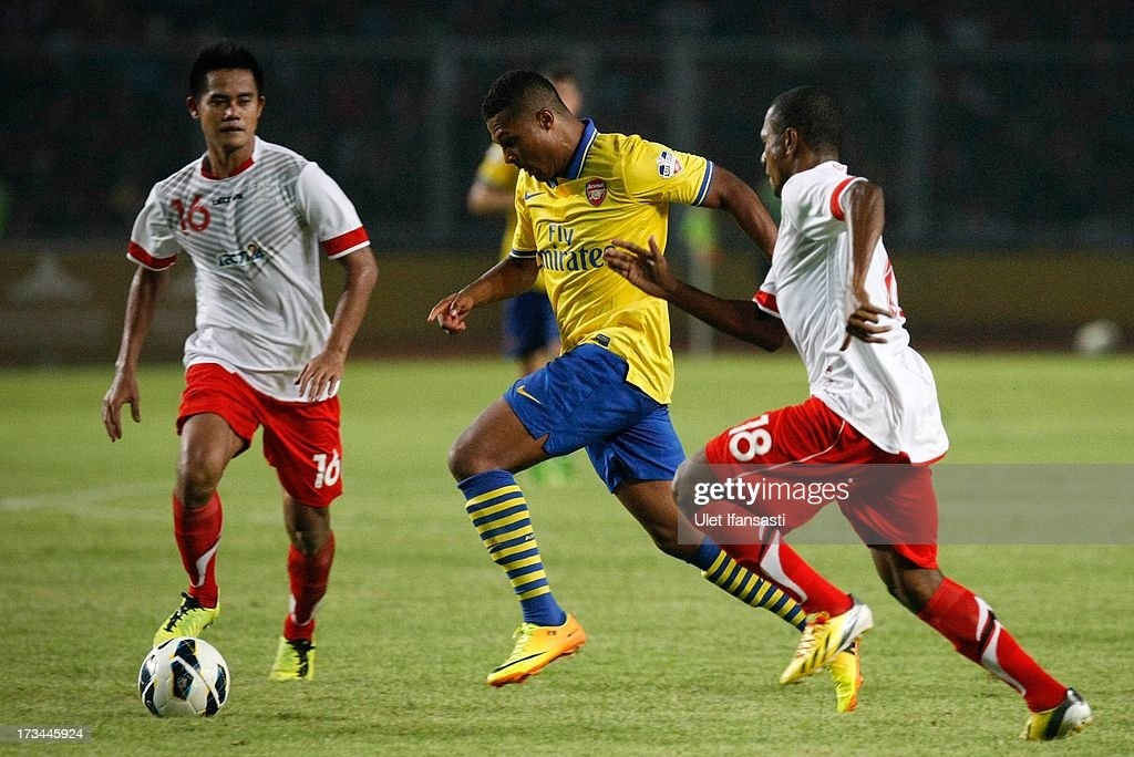 Serge Gnarby of Arsenal competes for the ball with Yustinus Pae of Indonesia All-Stars fight for the ball during the match between Arsenal and the Indonesia All-Stars at Gelora Bung Karno Stadium on July 14, 2013 in Jakarta, Indonesia.