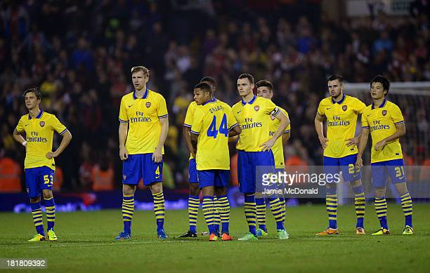 Serge Gnabry of Arsenal looks on after missing a penalty during the Capital One Cup third round match between West Bromwich Albion and Arsenal at The...