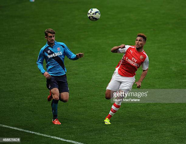 Serge Gnabry of Arsenal takes on Ben Barber of Stoke during the U21's Premier League match between Arsenal and Stoke City at Emirates Stadium on...