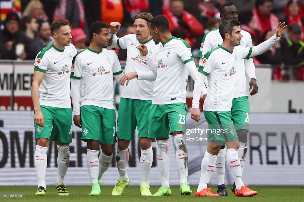 Serge Gnabry (2L) of Bremen celebrates his team's first goal with team mates during the Bundesliga match between 1. FSV Mainz 05 and Werder Bremen at Opel Arena on February 18, 2017 in Mainz, Germany.
