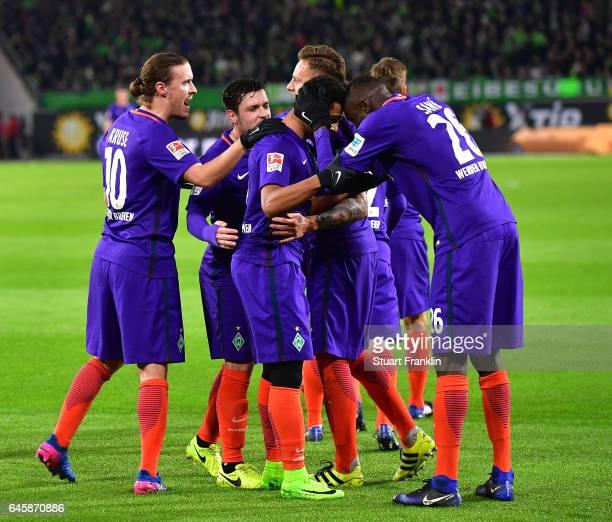 Serge Gnabry of Bremen celebrates scoring his second goal with teamate during the Bundesliga match between VfL Wolfsburg and Werder Bremen at...