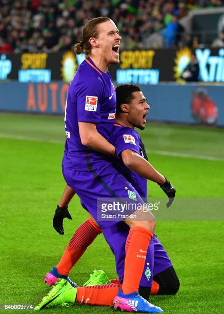 Serge Gnabry of Bremen celebrates scoring the first goal with Max Kruse during the Bundesliga match between VfL Wolfsburg and Werder Bremen at...