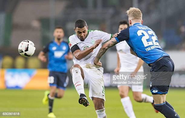 Serge Gnabry of Bremen challenges Kevin Vogt of Hoffenheim during the Bundesliga match between TSG 1899 Hoffenheim and Werder Bremen at Wirsol...