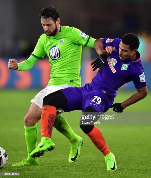 Serge Gnabry of Bremen is challenged by Christian Trsch of Wolfsburg during the Bundesliga match between VfL Wolfsburg and Werder Bremen at...