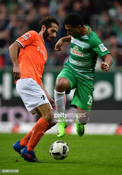 Serge Gnabry of Bremen is challenged by Hamit Altintop of Darmstadt during the Bundesliga match between Werder Bremen and SV Darmstadt 98 at...