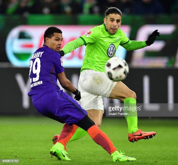 Serge Gnabry of Bremen is challenged by Ricardo Rodrguez of Wolfsburg during the Bundesliga match between VfL Wolfsburg and Werder Bremen at...