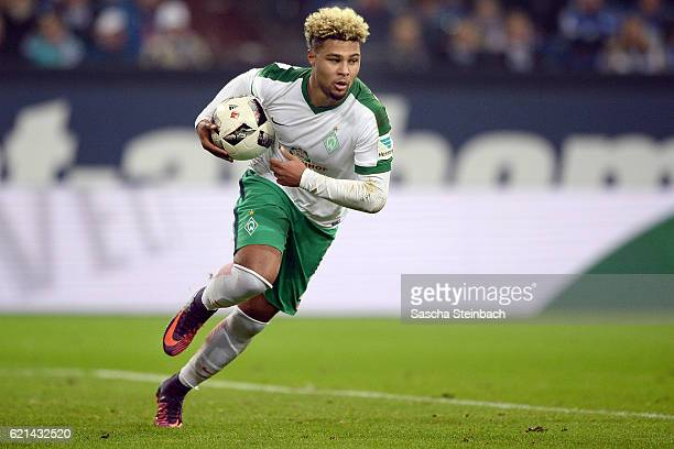 Serge Gnabry of Bremen reacts after scoring his team's first goal by a penalty during the Bundesliga match between FC Schalke 04 and Werder Bremen at...