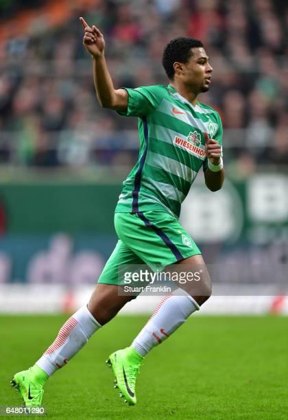 Serge Gnabry of Bremen signals during the Bundesliga match between Werder Bremen and SV Darmstadt 98 at Weserstadion on March 4 2017 in Bremen Germany