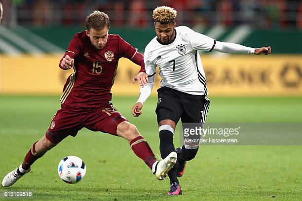 Serge Gnabry of Germany battles for the ball with Igor Bezdenezhnykh of Russia during the 2017 UEFA European U21 Championships Qualifier between...