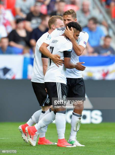 Serge Gnabry of Germany celebrates scoring his side's second goal with his team mates during the UEFA European Under21 Championship Group C match...