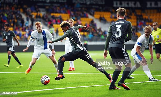 Serge Gnabry of Germany eludes Dani Hatakka and Matej Hradecky of Finland during the 2017 UEFA European U21 Championships Qualifier between U21...