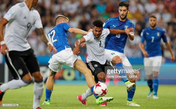 Serge Gnabry of Germany is challenged by Andrea Conti and Roberto Gagliardini of Italy during the UEFA European Under21 Championship Group C match...