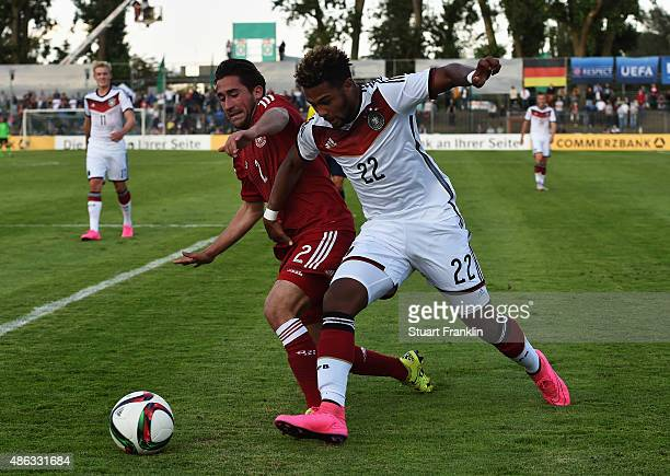 Serge Gnabry of Germany is challenged by Frederik Holst of Denmark during the International friendly match between U21 Germany and U21 Denmark at...