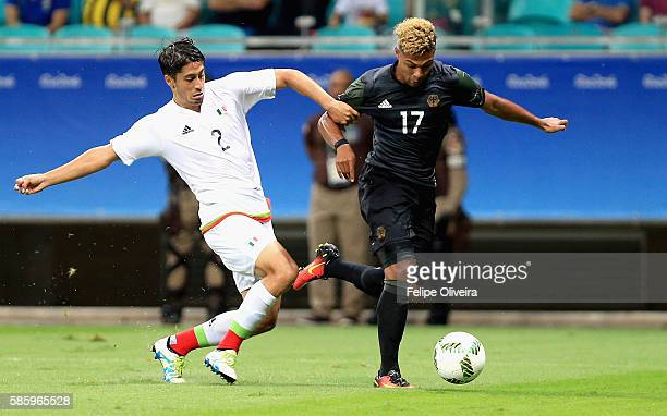 Serge Gnabry of Germany is challenged by Jose Abella of Mexico during the Men's Group C first round match between Mexico and Germany during the Rio...