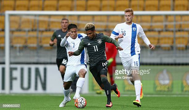 Serge Gnabry of Germany is challenged by Moshtagh Yaghoubi and Matej Hradecky of Finland during the 2017 UEFA European U21 Championships Qualifier...