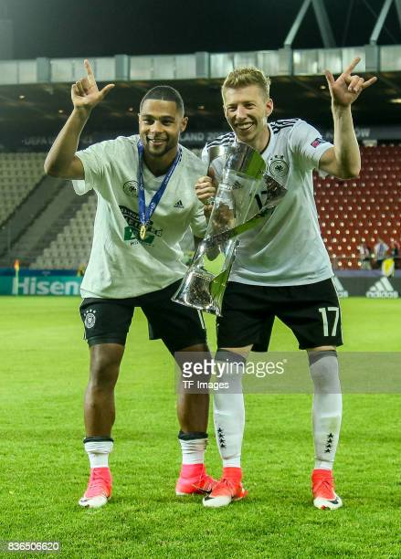 Serge Gnabry of Germany Mitchell Weiser of Germayn celebrates with the trophy after the UEFA U21 Final match between Germany and Spain at Krakow...