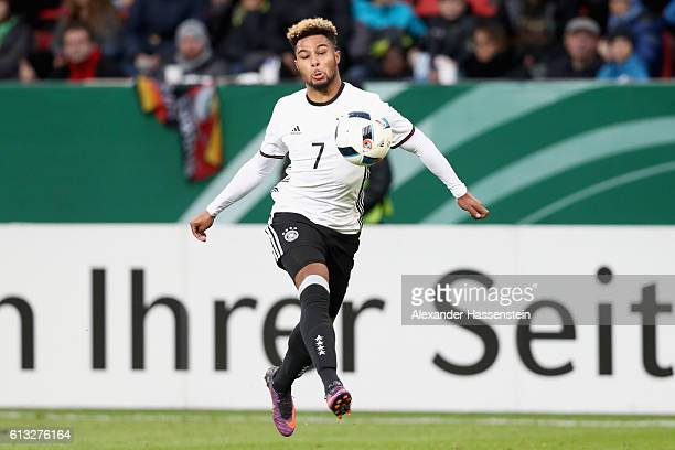 Serge Gnabry of Germany runs with the ball during the 2017 UEFA European U21 Championships Qualifier between Germany and Russia at Audi Sportpark on...