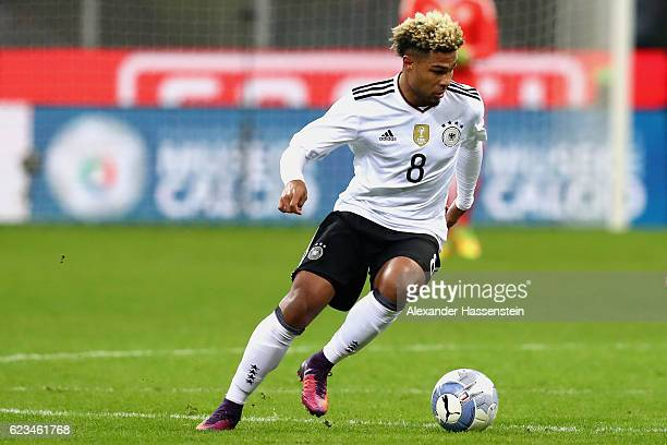 Serge Gnabry of Germany runs with the ball during the International Friendly Match between Italy and Germany at Giuseppe Meazza Stadium on November...
