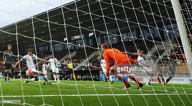 Serge Gnabry of Germany scores his team's first goal against goalkeeper Otso Virtanen and Sauli Vaisanen of Finland during the 2017 UEFA European U21...