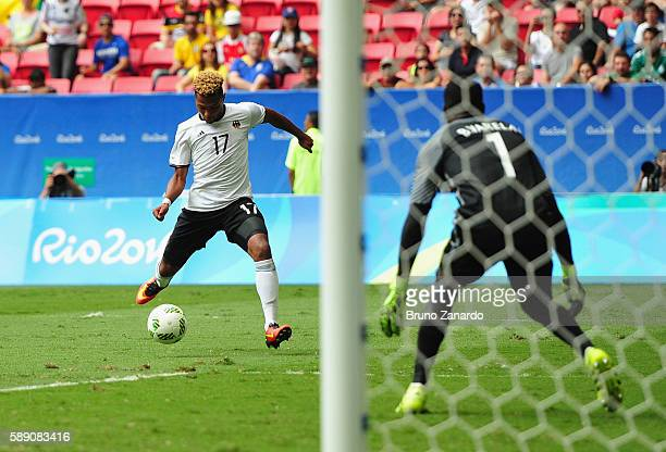 Serge Gnabry of Germany shoots to score against goalkeeper Varela Bruno of Portugal in the first half during the Men's Football Quarterfinal match on...