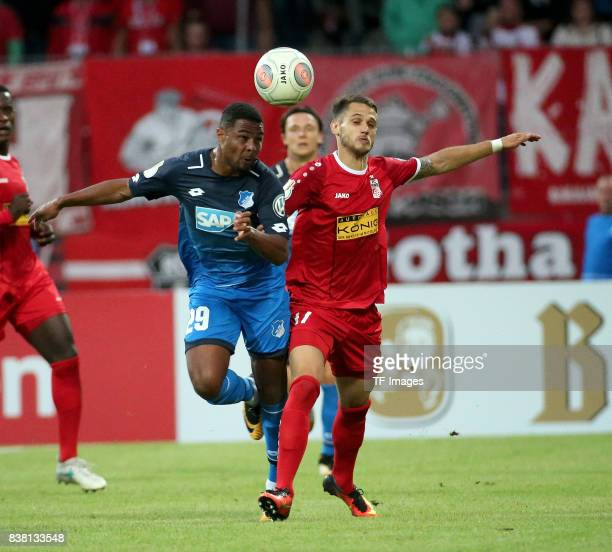 Serge Gnabry of Hoffenheim and Luka Marino Odak of Erfurt battle for the ball during the DFB Cup first round match between RotWeiss Erfurt and TSG...