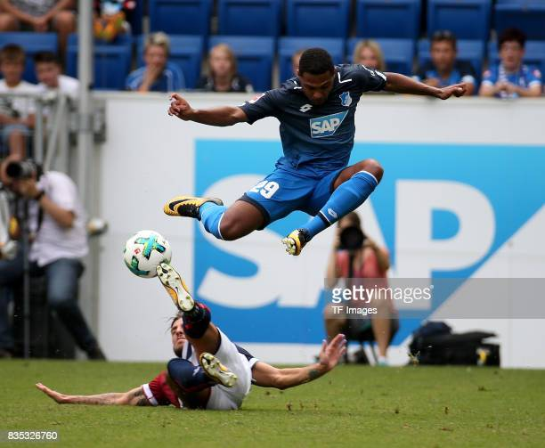 Serge Gnabry of Hoffenheim and Simone Verdi of Bologna battle for the ball during the preseason friendly match between TSG 1899 Hoffenheim and FC...