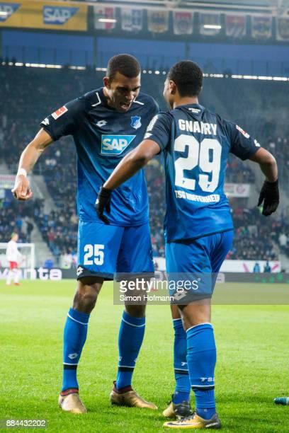 Serge Gnabry of Hoffenheim celebrates his team's second goal with team mate Kevin Akpoguma during the Bundesliga match between TSG 1899 Hoffenheim...