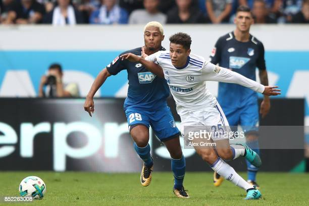 Serge Gnabry of Hoffenheim fights for the ball with Amine Harit of Schalke during the Bundesliga match between TSG 1899 Hoffenheim and FC Schalke 04...