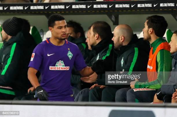 Serge Gnabry of SV Werder Bremen shake hands with team mates after his subtitution during the Bundesliga match between VfL Wolfsburg and Werder...