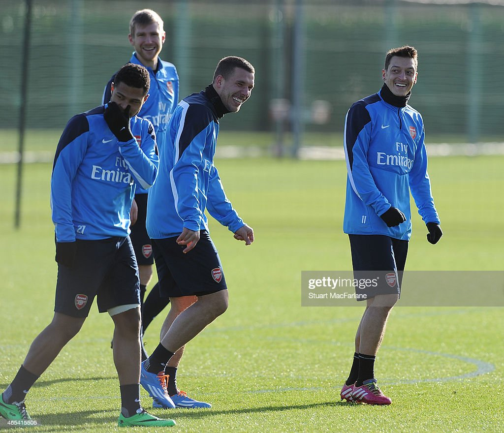 Serge Gnabry, Per Mertesacker, Lukas Podolski and Mesut Oezil of Arsenal during a training session at London Colney on January 27, 2014 in St Albans, England.