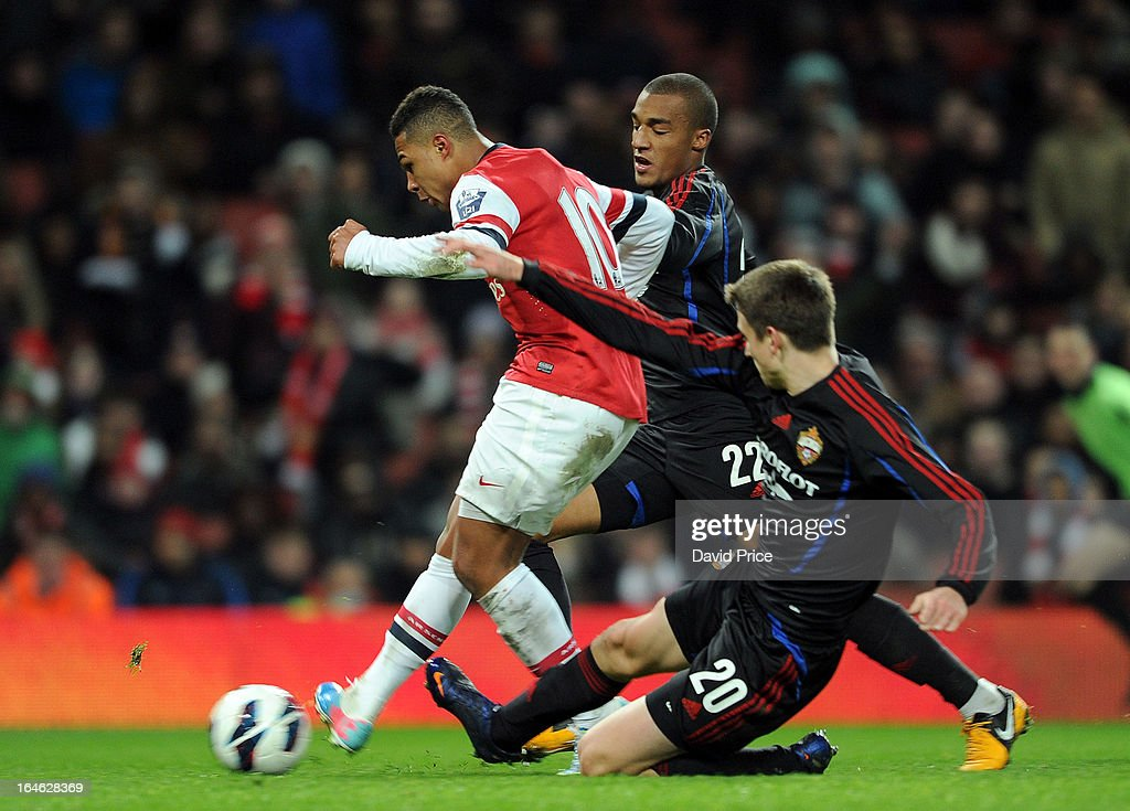 Serge Gnabry scores Arsenal's goal as he gets between Layonel Adams and Anton Polyutkin of CSKA during the NextGen Series Quarter Final match between Arsenal and PFC CSKA at Emirates Stadium on March 25, 2013 in London, England.